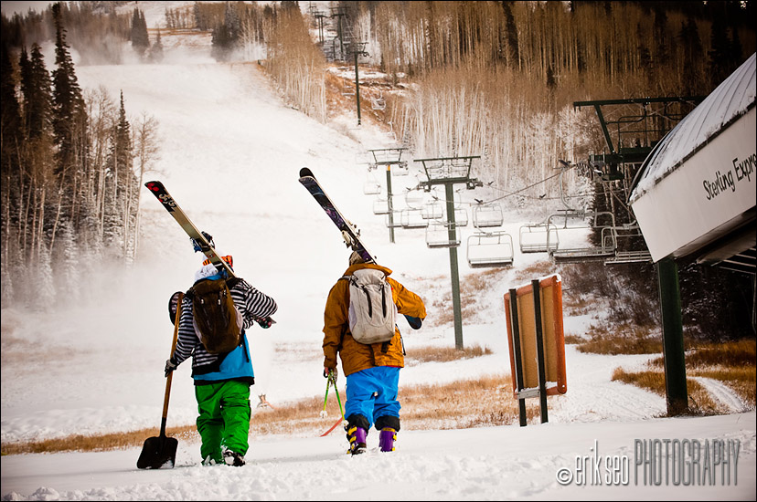 Joss Christensen and Alex Schlopy hiking up to the snowmaking pile in Deer Valley to build the backy jump